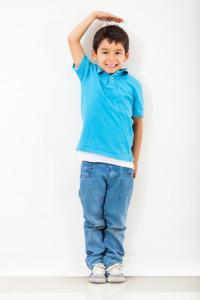 Boy growing tall